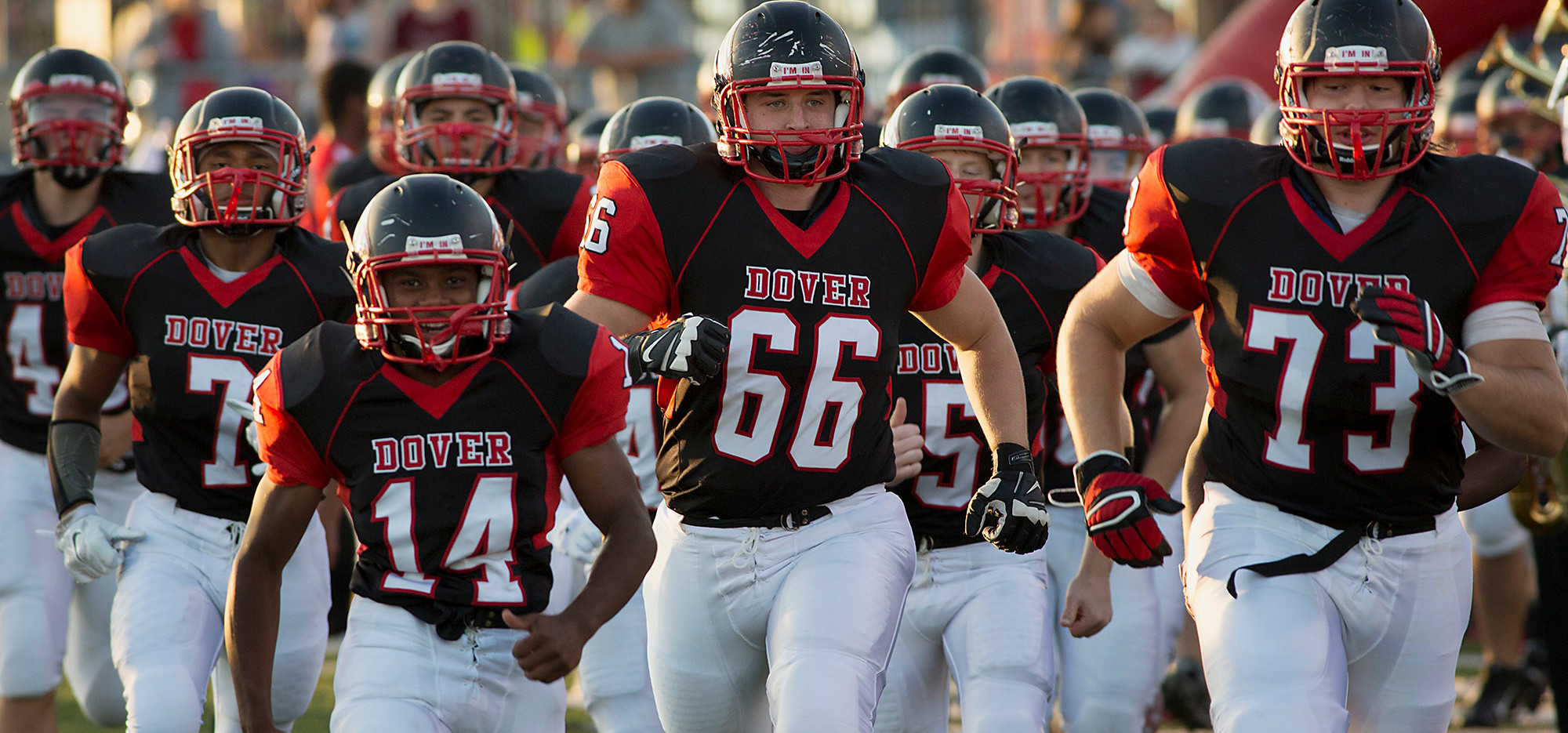 Dover's Tyrel Jones, Tyler Jacobson and Levi Murphy lead the Eagles onto the field for an early season game in 2014. The Eagles are coming off a 5-5 campaign, but have a new coach in Wayne Snelbaker with a mix of experience and promising youth. JOHN WHITEHEAD for the Daily Record/Sunday News